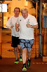 © Licensed to London News Pictures. 02/10/2017. Manchester, UK. Foreign secretary BORIS JOHNSON seen running with Sun Newspaper editor TONY GALLAGHER (left)on the morning of the second day of the Conservative Party Conference. The four day event is expected to focus heavily on Brexit, with the British prime minister hoping to dampen rumours of a leadership challenge. Photo credit: Ben Cawthra/LNP