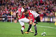July 15 2017: Arsenal player Alexandre Lacazette (9) goes around Western Sydney Wanderers Josh RISDON (4) at the International soccer match between English Premier League giants Arsenal and A-League team Western Sydney Wanderers at ANZ Stadium in Sydney.