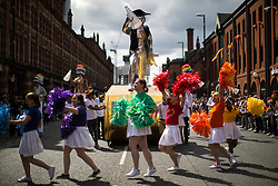 © Licensed to London News Pictures . 26/08/2017. Manchester , UK. 2017 Pride parade through Manchester City Centre . The annual festival , which is the largest of its type in Europe , celebrates LGBT life . Photo credit : Joel Goodman/LNP
