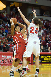 20 November 2010: Allyssa Decker bends under pressure from Emily Hanley during an NCAA Womens basketball game between the Southern Illinois-Edwardsville Cougars and the Illinois State Redbirds at Redbird Arena in Normal Illinois.
