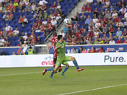 June 13, 2018 - Harrison, New Jersey, United States - Bradley Wright-Phillips (99) of Red Bulls & Kim Kee-hee (20) of Seattle Sounders fight for air ball during regular MLS game at Red Bull Arena Red Bulls won 2 -1  (Credit Image: © Lev Radin/Pacific Press via ZUMA Wire)