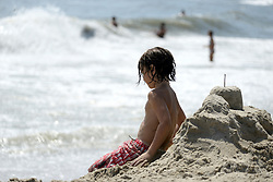 Children play in the surf at Chincoteague Island, Accomack County, Virginia, during Labor Day weekend on September 1, 2018. The American public holiday of Labor Day, on the first Monday in September is considered the unofficial  end of Summer.