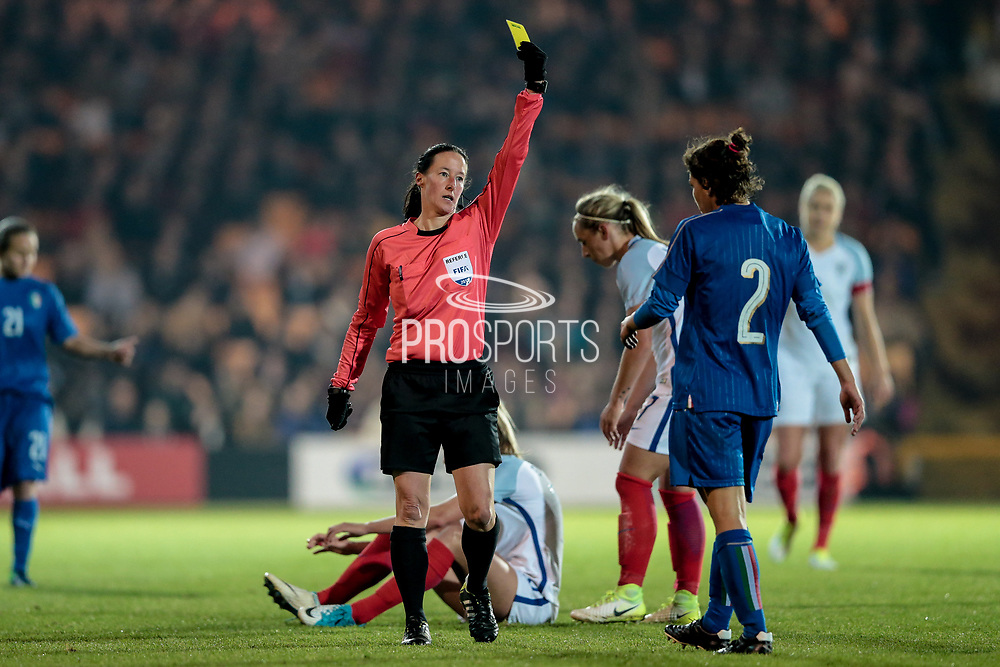 Morag Pirie (Referee) (Scotland) shows Elisa Bartoli (Italy) (Darl Fiorentina) a yellow card for a foul on Toni Duggan (England) (Manchester City) during the Women's International Friendly match between England Ladies and Italy Women at Vale Park, Burslem, England on 7 April 2017. Photo by Mark P Doherty.