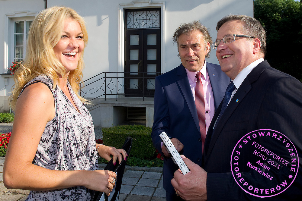 (L) Agnieszka Radwanska gives tennis racket to Bronislaw Komorowski - President of Poland during meeting in Belvedere Palace in Warsaw, Poland.<br /> <br /> Poland, Warsaw, July 08, 2013<br /> <br /> Picture also available in RAW (NEF) or TIFF format on special request.<br /> <br /> For editorial use only. Any commercial or promotional use requires permission.<br /> <br /> Photo by © Adam Nurkiewicz / Mediasport