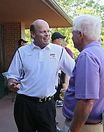 UNI football head coach Mark Farley talks with a supporter during the UNI Panther Prowl at Elmcrest Country Club, 1 Zach Johnson Dr NE, in Cedar Rapids on Monday afternoon, May 7, 2012. (Stephen Mally/Freelance)