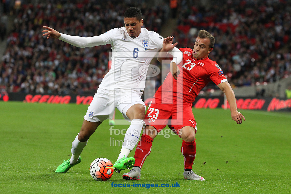 Chris Smalling of England and Xherdan Shaqiri of Switzerland in action and  during the UEFA Euro 2016 Qualifying match at Wembley Stadium, London<br /> Picture by Paul Chesterton/Focus Images Ltd +44 7904 640267<br /> 08/09/2015