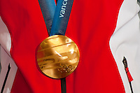 The Olympic Gold Medal is awarded to Swiss athlete Didier Defago during the 2010 Olympic Winter games in Whistler, BC Canada.