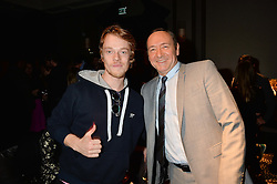 Left to right, ALFIE ALLEN and KEVIN SPACEY at the Old Vic 24 Hour Plays Celebrity Gala held at the Rosewood Hotel, 252 High Holborn, London on 24th November 2013.
