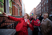 Tour guide Alice Mary demonstrates statues of monkeys playing billiards during the Walking Tour of Places of No Historical Interest , Festival of Fools, April 1st 2009, marking April Fool's Day, and the 43rd anniversary of the death of Irish author Flann O'Brien