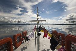Boat at Rio Negro (Black River), Amazonas State, Brazil.