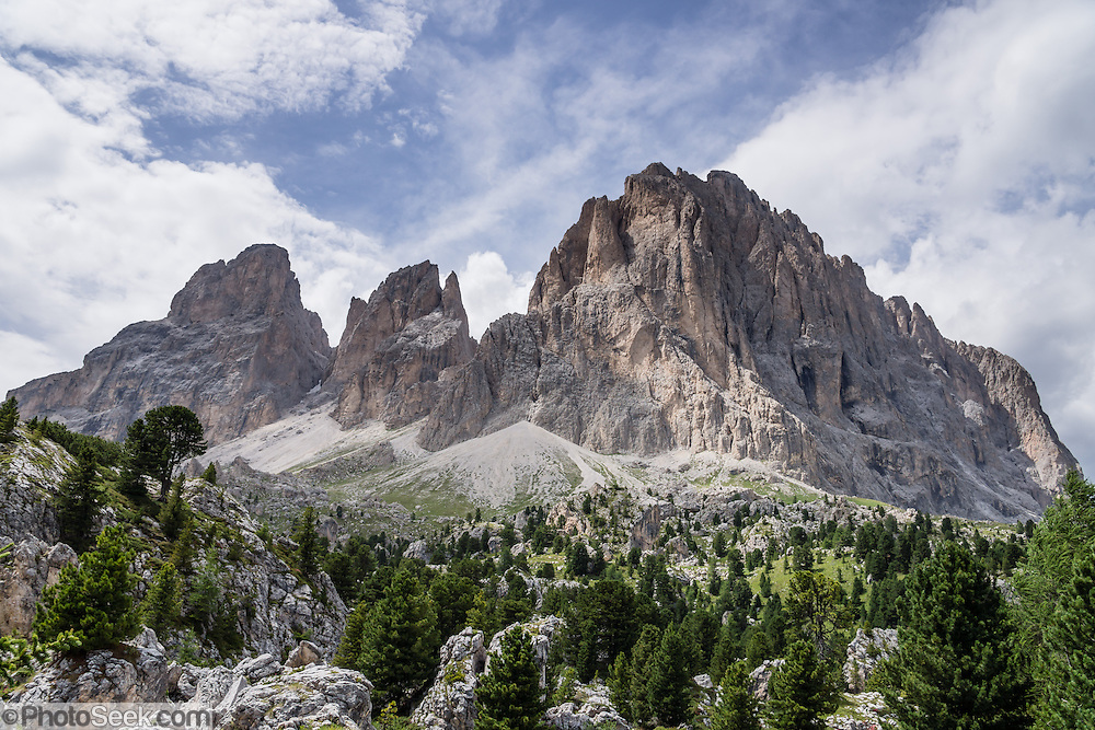 Langkofel/Sassolungo Group at Passo Sella, Val Gardena/Gröden, Dolomites, South Tyrol, Italy, Europe. For a scenic walk from Selva di Val Gardena, take the Ciampinoi lift for views of Alpe di Siusi then hike to Passo Sella and return by bus. The beautiful ski resort of Selva di Val Gardena (German: Wolkenstein in Gröden; Ladin: Sëlva Gherdëine) makes a great hiking base in the Dolomites, in the South Tyrol region (Trentino-Alto Adige/Südtirol) of Italy, Europe. UNESCO honored the Dolomites as a natural World Heritage Site in 2009.