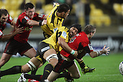 Victor Vito tackles Brent Ward. Super 15 rugby match - Crusaders v Hurricanes at Westpac Stadium, Wellington, New Zealand on Saturday, 18 June 2011. Photo: Dave Lintott / photosport.co.nz