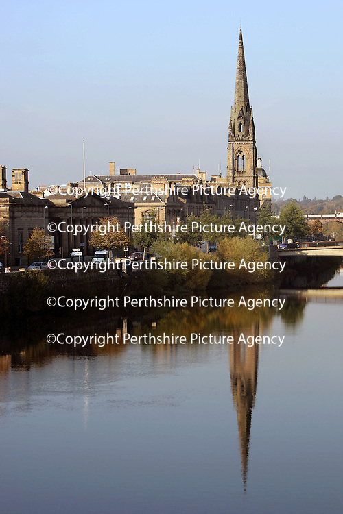 An autumnal view of Perth across the River Tay with the reflection of St Matthews Church<br /> <br /> Picture by Graeme Hart.<br /> Copyright Perthshire Picture Agency<br /> Tel: 01738 623350  Mobile: 07990 594431