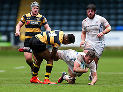 Lewis Pearson of Exeter Chiefs U18 is challenged by Taju Atta of Wasps U18 - Rogan Thomson/JMP - 16/02/2017 - RUGBY UNION - Sixways Stadium - Worcester, England - Wasps U18 v Exeter Chiefs U18 - Premiership Rugby Under 18 Academy Finals Day 3rd Place Play-Off.