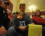 Mike Roberts, District 5 supervisor candidate, and his son Max listen to vote totals at the Lafayette County Courthouse in Oxford, Miss. on Tuesday, November 8, 2011.