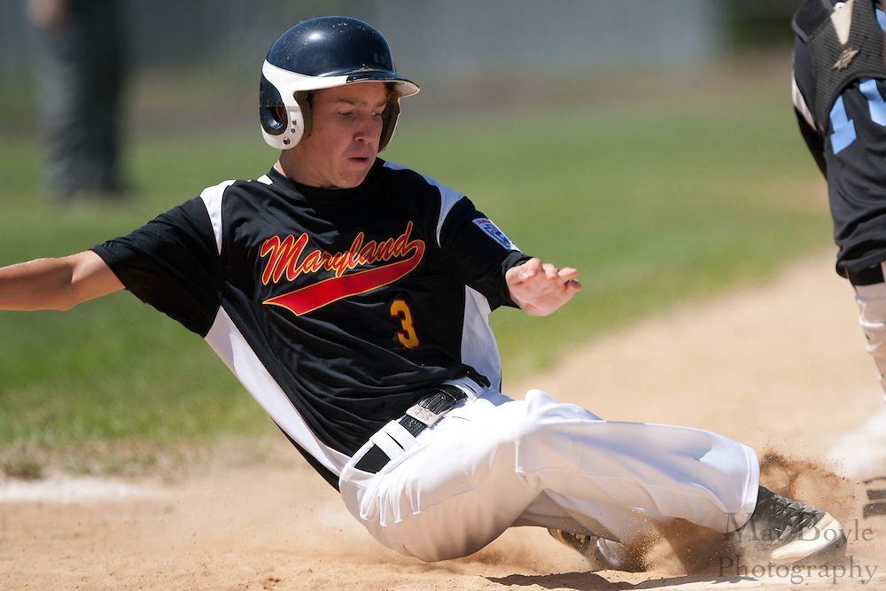 Maryland's Shaw Pritchett slides into home  to score a run for Markland during the winner take all final of the Eastern Regional Senior League tournament between Pennsylvania and Maryland held in West Deptford on Thursday, August 11.