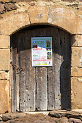 Poster in mountain village of Somaniezo advertising Fiesta de la Virgin de La Luz in Aniezo, Cantabria Spain