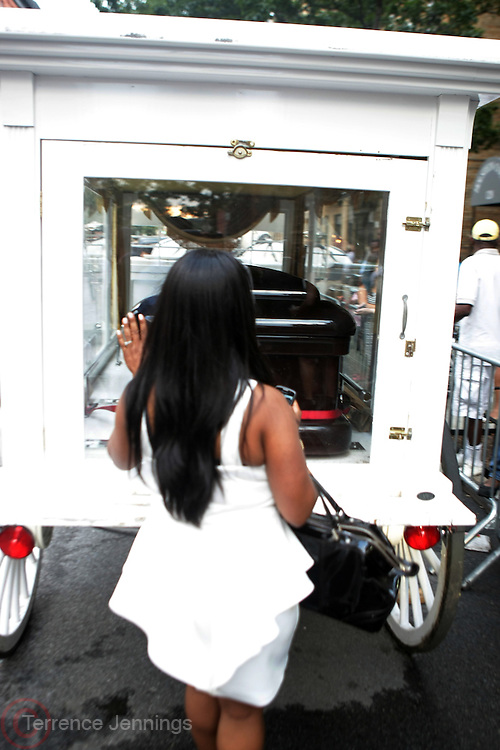 July 24, 2012-New York, NY:  Slyvia Woods's body is removed from the Abyssinia Baptist Church at the official Slyvia Woods Harlem Community memorial and send off through the streets of Harlem. Sylvia Woods was an American restaurateur who co-founded the landmark restaurant Sylvia's in Harlem on Lenox Avenue, New York City with her husband, Herbert Woods, in 1962. (Photo by Terrence Jennings)