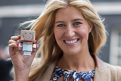 © licensed to London News Pictures. London, UK 09/05/2013. Made in Chelsea's Cheska Hull holding a carton figure of herself as she hands over a petition to Number 10, Downing Street, calling for the government to support global food security. Fairtrade campaigners and members of The Co-operative are asking the government to use the G8 summit to unlock greater support for smallholder farmers. Photo credit: Tolga Akmen/LNP