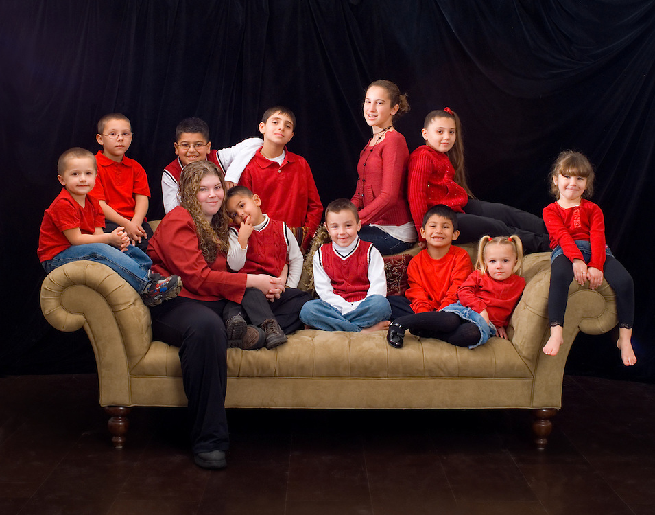 Cousins, photographed as a gift for grandma and grandpa.  Children has been very precisely posed according to how they got along with each other and attitude.
