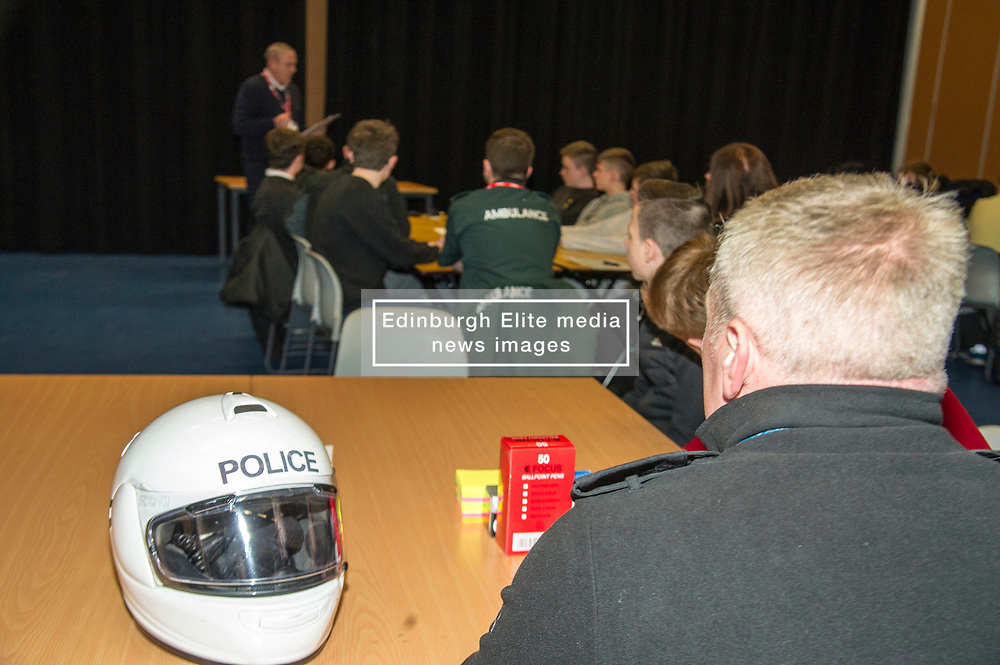Pictured: Community Inspector Stevei Sutherland spoke as Steph Inglis' silver medal was passed around the students.<br /> <br /> Police Scotland visited Craigroyston High Schoolto today to host motorcycle safety seminar at the secondary school. The event looked at motorbike/vehicle misuse and the consequences involved after 50 students from the school were identified as potentially being involved in such activities. One of the school's 14 year old pupils, Bradley Williams died recently in a motorcycle accident recently and some of his relatives were their to plead with the students to be aware of the dangers of going on bikes with out the appropriate training and licences.<br /> Ger Harley | EEm 27 April 2017