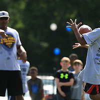 AARON STEWART || BUY AT PHOTOS.DJO<br /> <br /> Pro Football Player and former MSU Bulldog Chris Jones throws a pass to 8-year-old Brayden Holman at the All-Star Football Camp benefiting the Boys & Girls Club Saturday morning.
