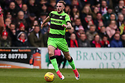 Forest Green Rovers Carl Winchester(7) runs forward during the EFL Sky Bet League 2 match between Lincoln City and Forest Green Rovers at Sincil Bank, Lincoln, United Kingdom on 3 November 2018.