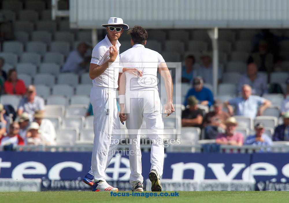Stuart Broad of England signals to Captain Alastair Cook of England that Steven Finn of England will not be able to continue during Day Four of the fourth Investec Test Match at the Kia Oval, London<br /> Picture by Alan Stanford/Focus Images Ltd +44 7915 056117<br /> 14/08/2016