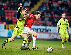 LONDON, ENGLAND - Saturday, January 30, 2010: Charlton Athletic's Christian Dailly feels the pressure from Tranmere Rovers' John Welsh as Tranmere go on the attack during the Football League One match at the Valley. (Photo by Gareth Davies/Propaganda)
