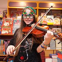 "Hannah Morrisey playing violin as part of ""Santa Tales"" at the Ennis Bookstore"