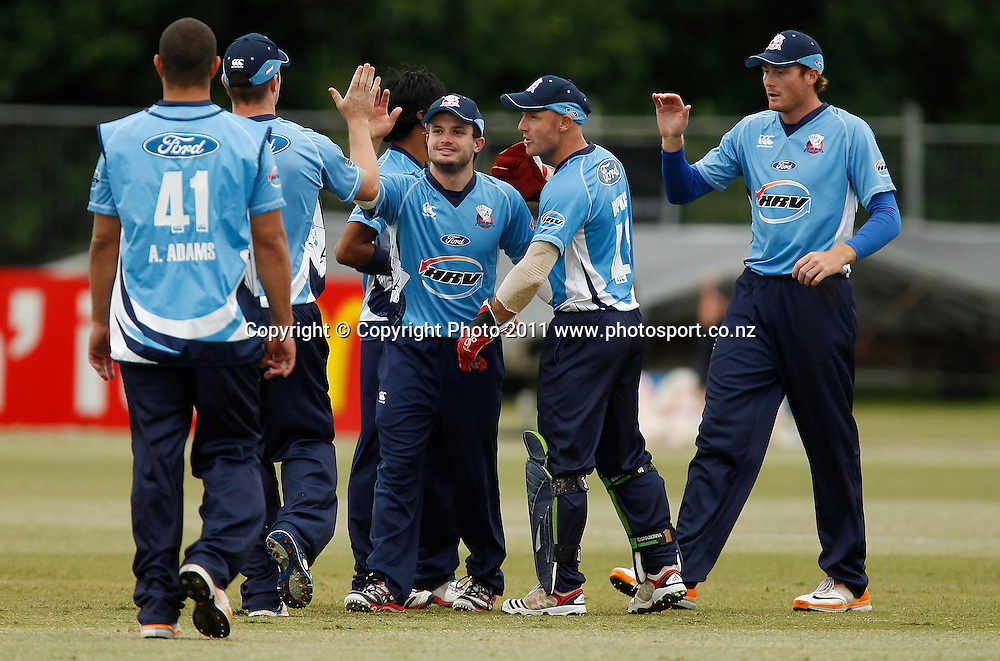 Aces players celebrate a wicket during the HRV Cup Cricket Twenty-20,  Auckland Aces v Wellington Firebirds, Colin Maiden Park Auckland, Sunday 18 December 2011. Photo: Simon Watts/www.photosport.co.nz
