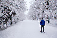 Snowshoeing along a trail in Jester Park during a February snowstorm. Model: Stephanie Coffman