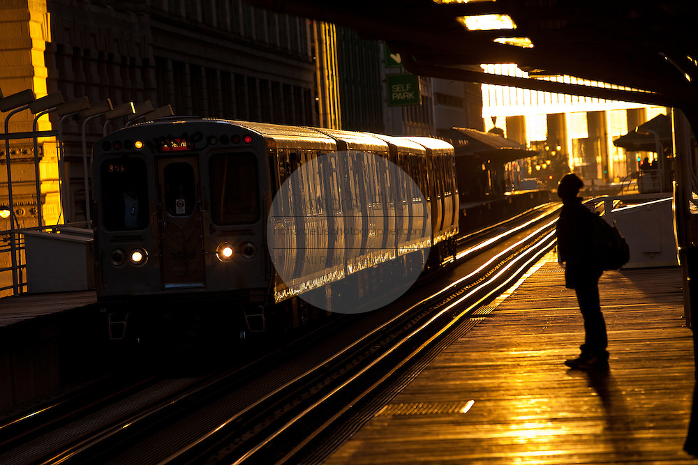 """Sunrise illuminates the elevated tracks of the Chicago rapid transit system known as the""""L""""  in Chicago, IL, USA."""