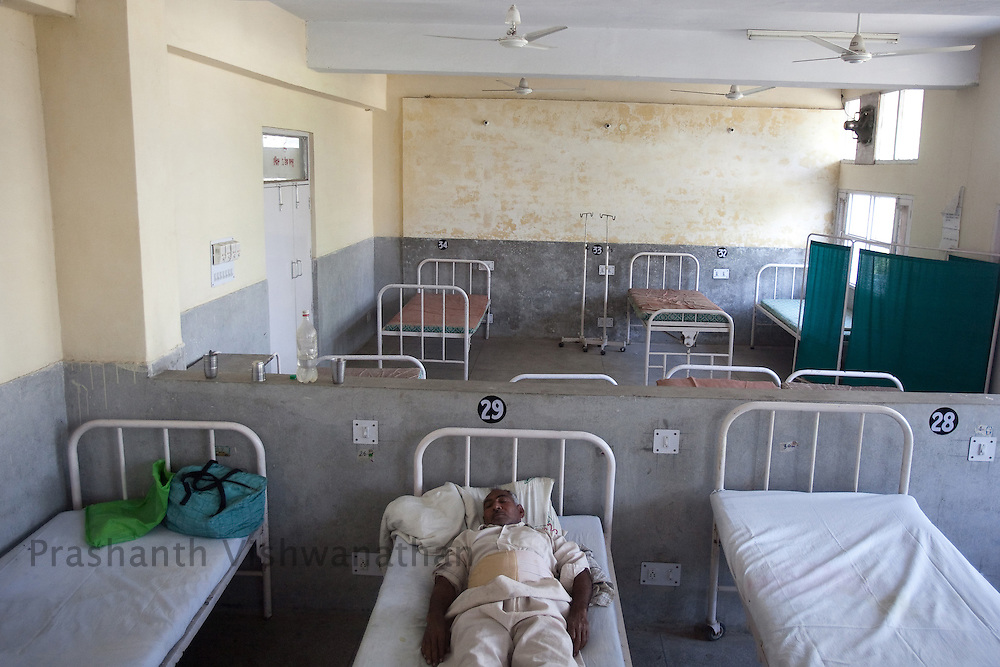A lone patient sleeps in the post operation recovery ward of the district hospital in Jindh, India, on Saturday, April 10, 2010. Photographer: Prashanth Vishwanathan/Bloomberg