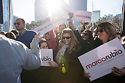 Supporters receive signs before Senator Marco Rubio speaks during a campaign rally on February 26, 2016 in Dallas, Texas.  (Cooper Neill for The New York Times)