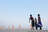Boys doing dogfights with their kites in the ghats.