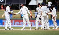 August 6, 2017 - Colombo, Sri Lanka - Indian captain Virat Kohli (2L) is congratulated by Sri Lanka's Nuwan Pradeep (L) after India defeated Sri Lanka by an innings and 53 runs during the 4th Day's play in the 2nd Test match between Sri Lanka and India at the SSC international cricket stadium at the capital city of Colombo, Sri Lanka on Sunday 6 August 2017. (Credit Image: © Tharaka Basnayaka/NurPhoto via ZUMA Press)
