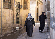 Muslim women in an alley of the old city of Sanliurfa (also called Urfa), southeastern Turkey.