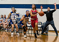 Winnisquam's Makenzie Snow and Belmont's Julianna Estremera take the court for first round play of the 44th annual Holiday Basketball Tournament played at Gilford Middle/High School on Wednesday afternoon.  (Karen Bobotas/for the Laconia Daily Sun)