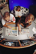 "Video Suite animators working at Pacific Data Images (PDI) in Sunnyvale, California.  1992. The company does computer animation and digital film effects: morphing. In 1996 PDI began collaborating with DreamWorks SKG, which then acquired PDI in 2004. .Creating believable 3D animated characters (War Games) and seamless transformations known as morphing (""Black and White"" and ""She's Mad""), PDI has been at the forefront of computer imagery. The studio pushed the boundaries of morphing in Michael Jackson's video ""Black or White"" with a sequence of twelve dynamic transformations of moving characters. In the innovative David Byrne video ""She's Mad,"" PDI pioneered the technology called performance animation, capturing the motion of David Byrne and infusing an animated character with his distinctive motion. ."