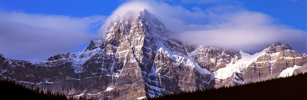 Mount Chephren wears a mantle of clouds in Banff National Park, Alberta, Canada. ©Ric Ergenbright