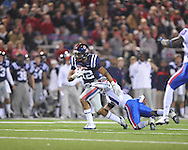 Ole Miss' Donte Moncrief (12) is tackled by Louisiana Tech's Chad Boyd (31) in Oxford, Miss. on Saturday, November 12, 2011.