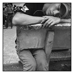 Portrait of a man sleeping on a bench of Hoan Kiem lake in Hanoi