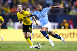 July 20, 2018 - Chicago, IL, U.S. - CHICAGO, IL - JULY 20: Manchester City forward Leroy Sane (19) battles with Borussia Dortmund forward Maximilian Philipp (20) for the ball during an International Champions Cup match between Manchester City and Borussia Dortmund on July 20, 2018 at Soldier Field in Chicago, Illinois. (Photo by Robin Alam/Icon Sportswire) (Credit Image: © Robin Alam/Icon SMI via ZUMA Press)