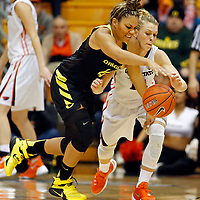 Oregon's Kat Cooper, left, and Oregon State's Jamie Weisner fight for a loose ball in the second half of an NCAA college basketball game, in Corvallis, Ore., on Friday, Jan. 8, 2016. Oregon State won 60-33. (AP Photo/Timothy J. Gonzalez)