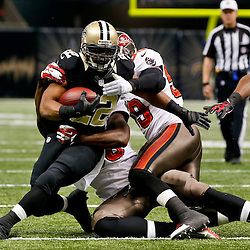 Dec 29, 2013; New Orleans, LA, USA; Tampa Bay Buccaneers defensive end Steven Means (96) tackles New Orleans Saints running back Mark Ingram (22) during the second half of a game at the Mercedes-Benz Superdome.The Saints defeated the Buccaneers 42-17. Mandatory Credit: Derick E. Hingle-USA TODAY Sports
