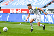 Leeds United midfielder Jack Harrison (22) passes the ball during the EFL Sky Bet Championship match between Wigan Athletic and Leeds United at the DW Stadium, Wigan, England on 17 August 2019.