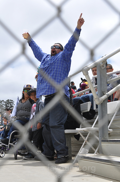 A man gives a shout-out to his favorite driver at the 2016 Monster Jam on Sunday, May 15th at the Salinas Sports Complex.