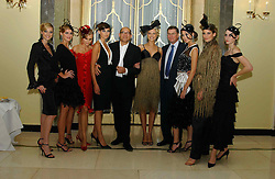 """BRUCE OLDFIELD and LORD ASHCROFT with models at a party to celebrate the publication of Bruce Oldfield's autobiography """"Rootless"""" held in aid of Crimestoppers at Claridge's, Brook Street, London W1 on 22nd September 2004.<br /><br />NON EXCLUSIVE - WORLD RIGHTS"""