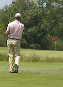 2007 Boyne Tournament of Champions winner Michael Harris of Troy plays his second his third shot land left of the flag on the par 5 18th of Boyne Mountains Alpine course.